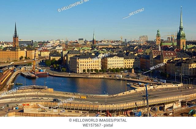 Cityscape with island of Gamla Stan (old town) and on the skyline to the left spire of Riddarholmskyrkan church on Riddarholmen island, Stockholm, Sweden