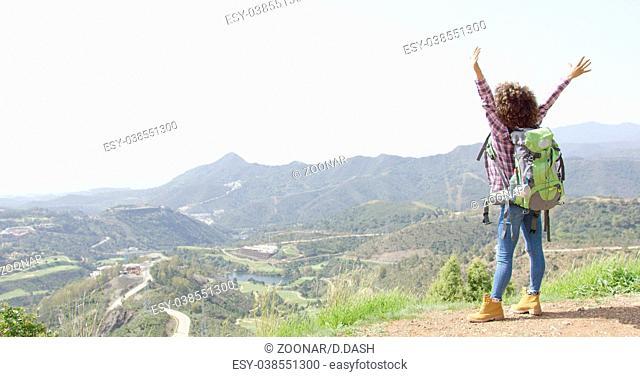 Happy tourist on summit