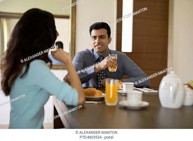 India, Man and woman having breakfast