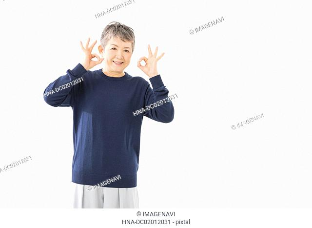 Senior woman with OK gesture