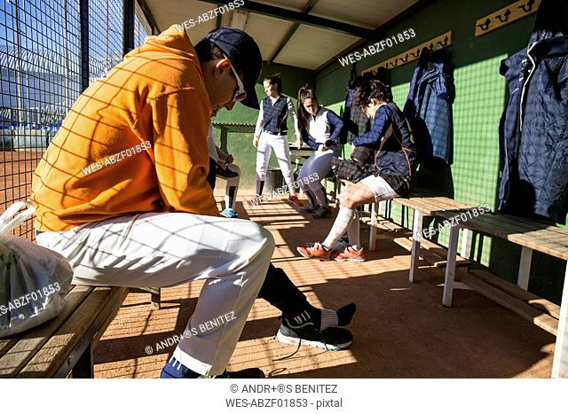 Baseball players getting ready before the game