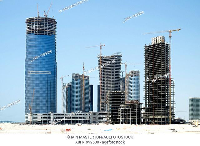 Modern high rise towers under construction at new business and residential district on Al Reem Island in Abu Dhabi United Arab Emirates