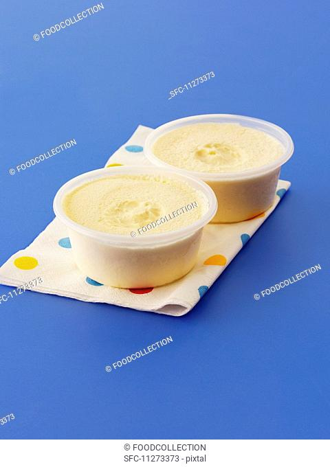 Vanilla ice cream in plastic bowls