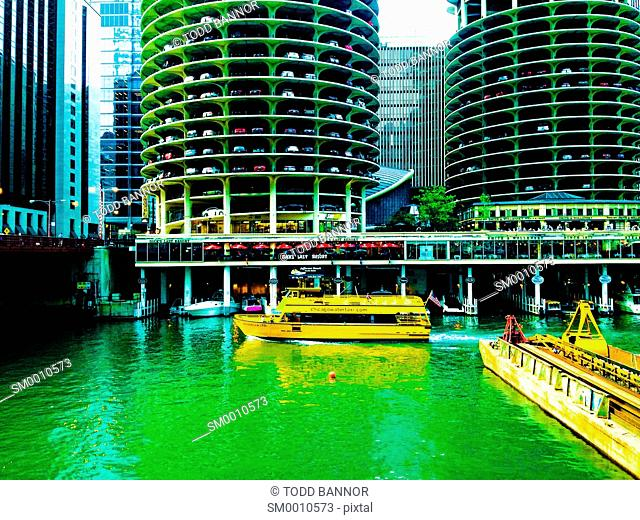 Chicago Water Taxi cruising past Marina City on Chicago River
