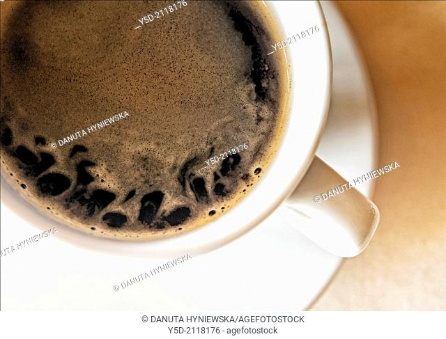 Close-up white cup with coffee taken directly above
