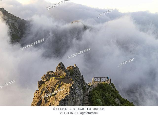 Hiker admiring the view from Ninho da Manta lookout. Pico do Arieiro, Funchal, Madeira region, Portugal