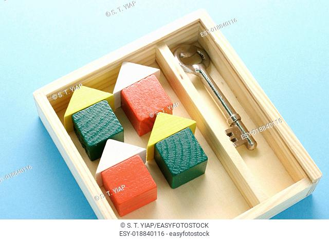 Toy houses and key, real estate concept