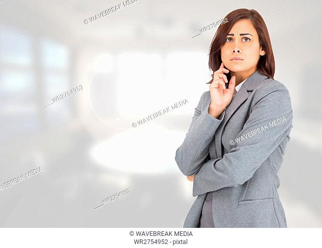 Anxious businesswoman against bright background