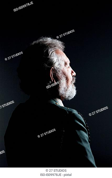 Senior man with eyes closed wearing military uniform