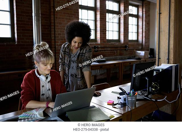 Designers working in laptop at office