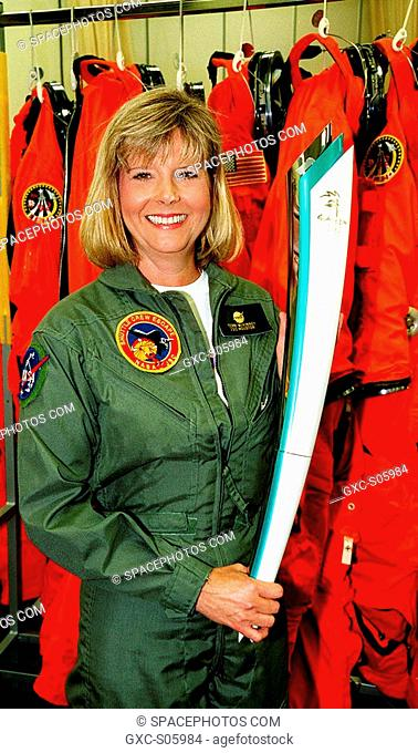 05/29/2000 --- Teri McKinney, with Shuttle Crew Escape, Johnson Space Center, holds a replica of the Olympic torch carried aboard Space Shuttle Atlantis on...