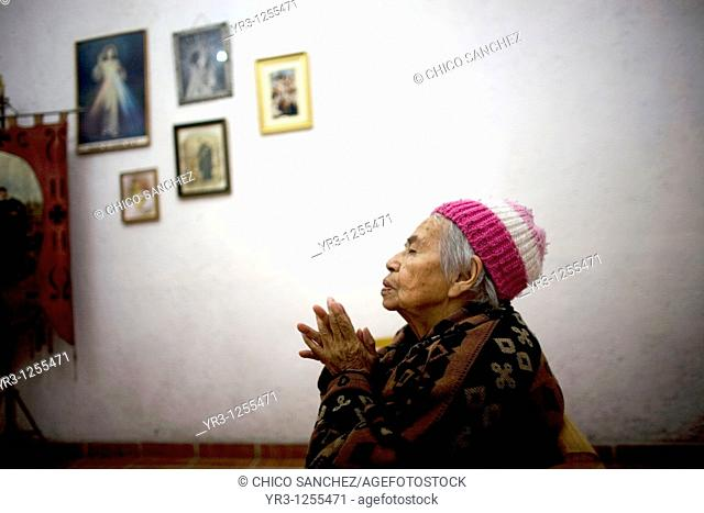 Esperanza Sanchez, 86, prays in the chapel of the Our Lady of Guadalupe Home for the Elderly, Mexico City