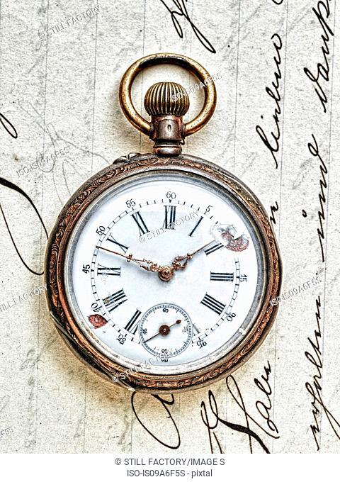 Pocket watch on handwritten letter