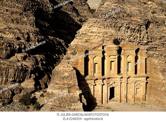 The famous and elaborately carved façade of Al Deir (the Monastery), carved out of a sandstone rock face. Jordan (Hashemite Kingdom of)
