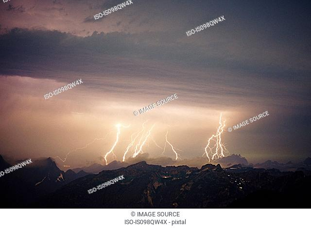 Lightning storm over cascade mountains