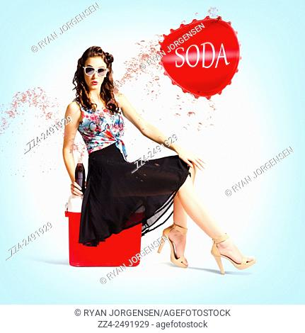 Full body pin up image of a beautiful stylish model popping the lid on a soda bottle while on a red cooler. Pop top pin up