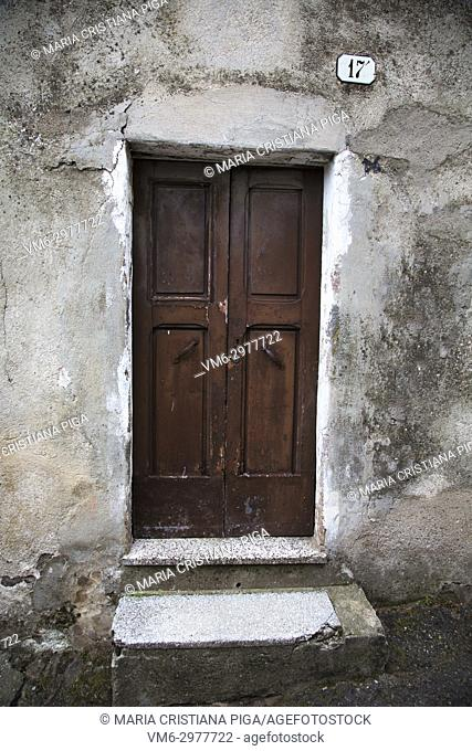 Old wooden door in the small village of Bortigali, Sardinia, Italy
