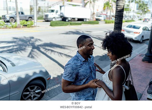 USA, Florida, Miami Beach, smiling affectionate young couple in the city