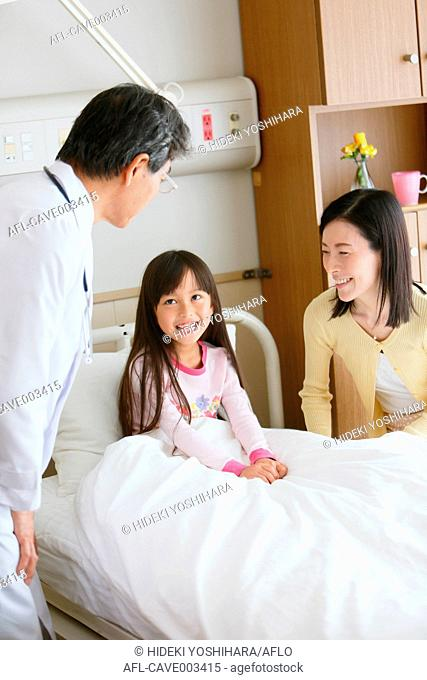 Japanese doctor checking patient