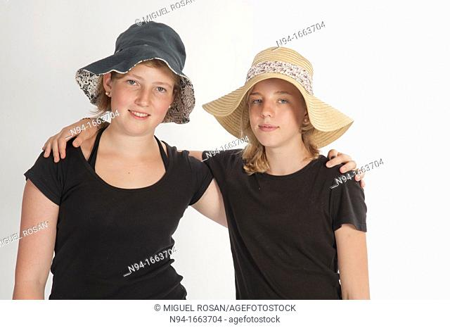 Two teenage girls with hats