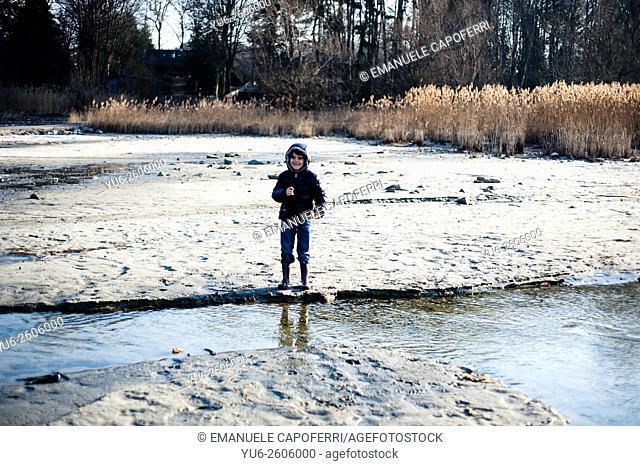 Children on the Lake Maggiore Winter Beach, Ispra, Lombardy, Italy