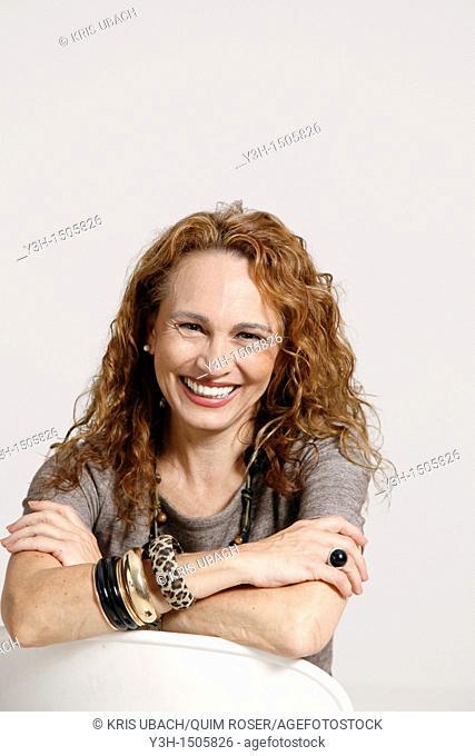 Studio shot of woman, smiling