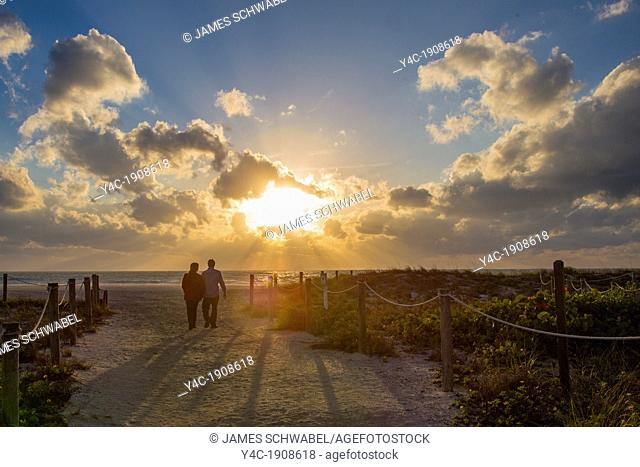 Couple on Venice Beach in Venice Florida at sunset