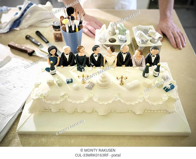 Wedding cake with top table decorations
