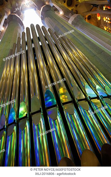 looking up at colourful reflections on organ pipes
