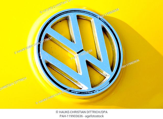 A yellow Volkswagen Fridolin with the VW logo on it at the Maikaefertreffen (May Beetle Meeting) in Hanover (Germany), 01 May 2019