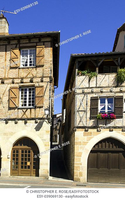 Quaint old buildings with colourful shutters in the streets and squares of Figeac, Lot 46, France, Europe