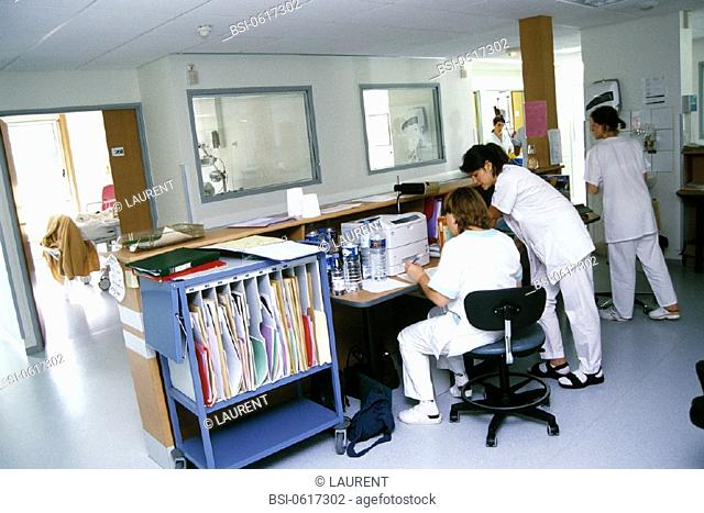 NURSE WITH PATIENT'S RECORD<BR>Photo essay.<BR>Chatellerault Hospital (Camille Guérin Hospital) in the French department of Vienne