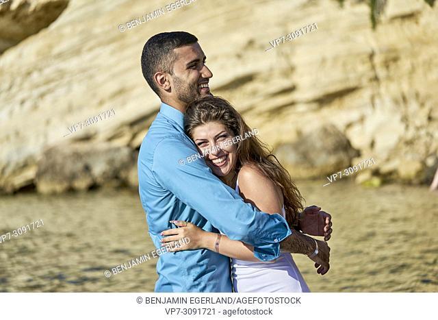 couple at seaside, beach, holiday in Chersonissos, Crete, Greece, enjoying love