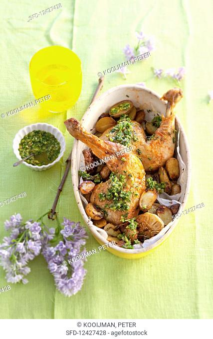 Chicken legs with potatoes, garlic and salsa verde