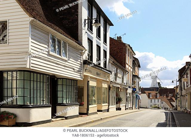 Stone Street, Cranbrook, Kent, England, UK, Britain, Europe  Street scene with typical old Kentish buildings and view to Union windmill in Wealden village once...