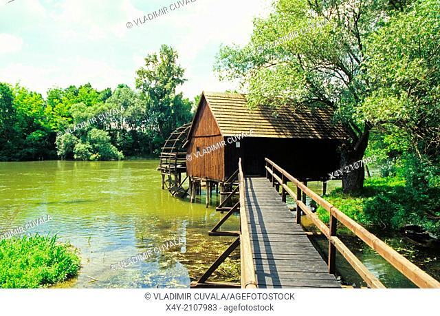 Old wooden flour mill on the river Maly Dunaj near village Tomasikovo, Slovakia