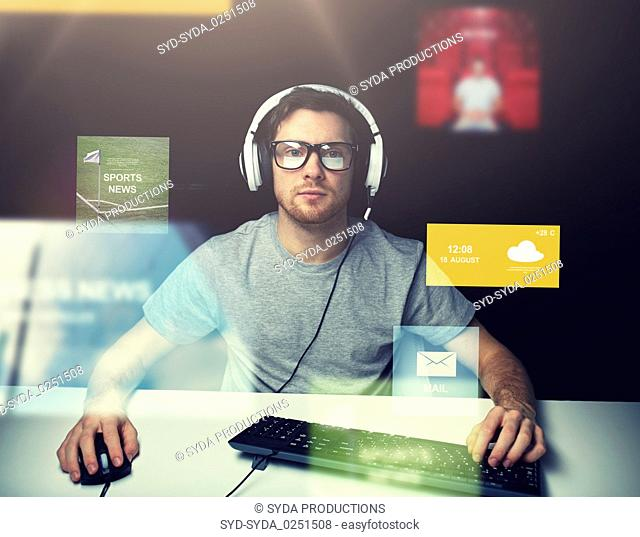 man in headset computer over virtual media screens