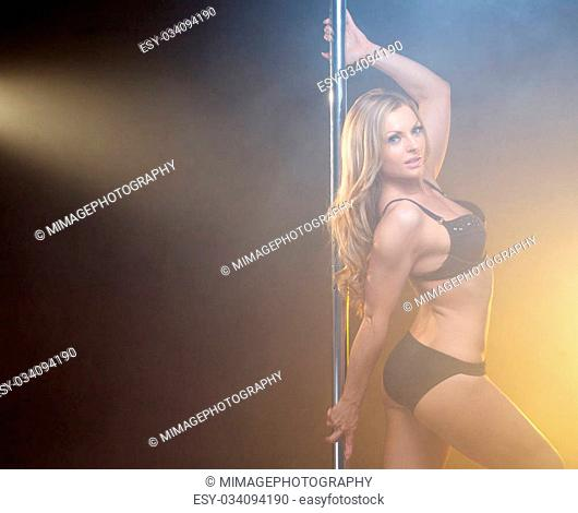 Close up portrait of a beautiful young pole dancer with blond hair