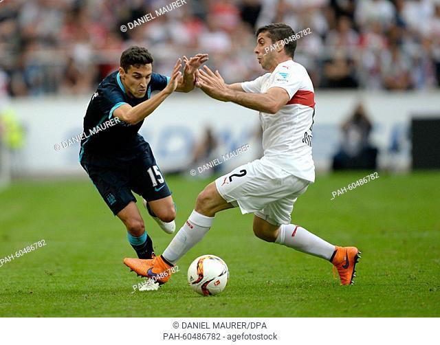 Stuttgart's Emiliano Insua (R) and Manchester's Jesus Navas vie for the ball during a friendly between German Bundesliga soccer club VfB Stuttgart and England's...