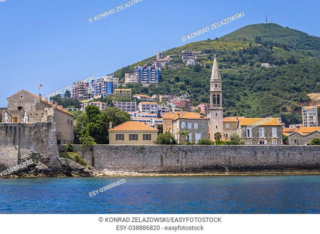 View from sea on the Old Town and bell tower of John the Baptist cathedral in Budva city on the Adriatic Sea coast, Montenegro