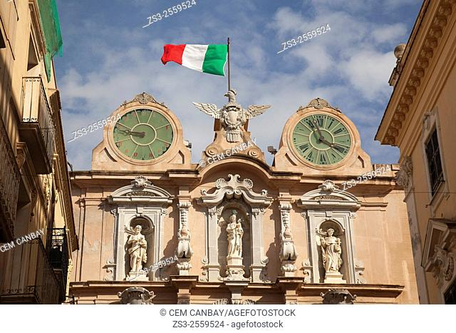 Twin watches and the flag at the top of the Palazzo Senatorio Via Vittoria Emanuele street, Trapani, Sicily, Italy, Europe