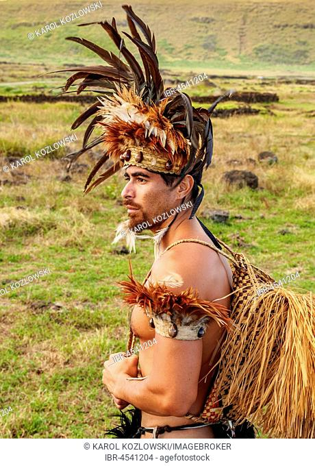 Native Rapa Nui man in tradititional costume at Ahu Tongariki, Rapa Nui National Park, Easter Island, Chile