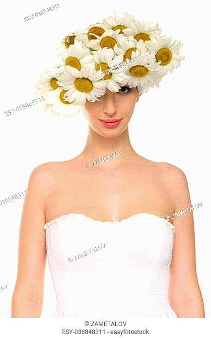 beautiful woman in hat of daisies and white dress isolated on white