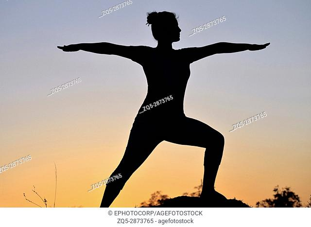 Silhouette of young girl in yoga pose, Pune, Maharashtra