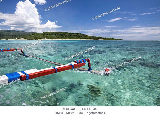 Indonesia, Lesser Sunda Islands, Alor Island, Mali beach, traditional boat sailling between Alor mainland and Sika Island