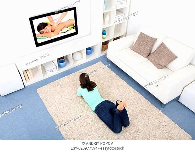 Woman Watching Television At Home