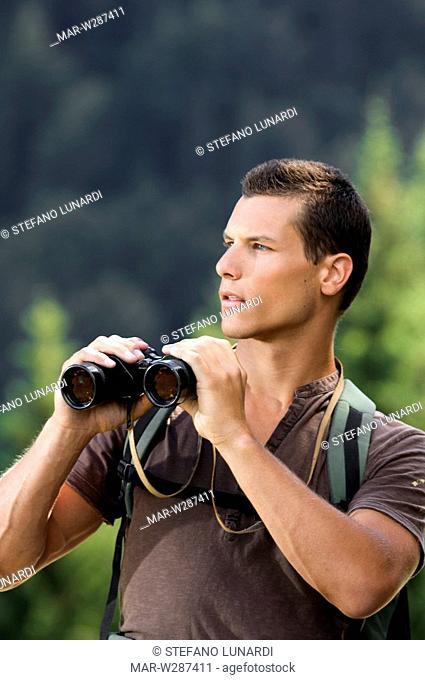 man with binoculars, mountain