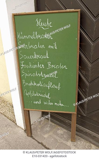 Sign in front of a Heuriger wine tavern in Klosterneuburg, Niederösterreich near Vienna. Austria