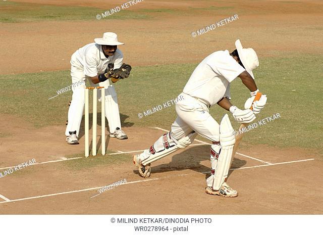 Indian left handed batsman in action playing defensive shot in cricket match MR705I