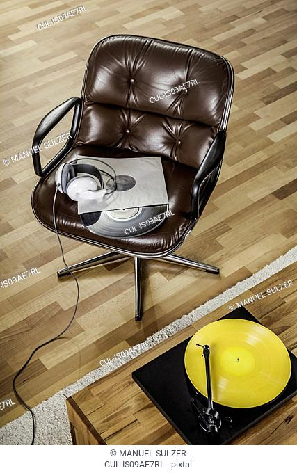 Retro brown leather armchair and vinyl records